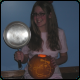 Bespectacled Paula Polestar and Her Orange Mr. Saturn Thumbnail